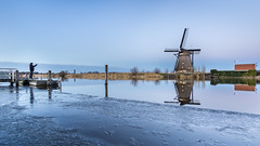 Hoping for a good catch (Rob Schop) Tags: wideangle winter sonya6000 molens avond nederland outdoor cold ijs fisherman visser pola y samyang12mmf20 blue windmill a6000 hoyaprofilters ice kinderdijk f8