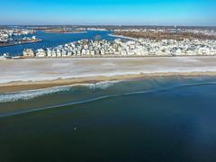 A snow-covered Manasquan Beach and the Atlantic Ocean, captured by a DJI Phantom 4 drone. (apardavila) Tags: atlanticocean djiphantom4 jerseyshore manasquan manasquanbeach manasquanriver aerial beach beachfronthomes drone morning sky snow