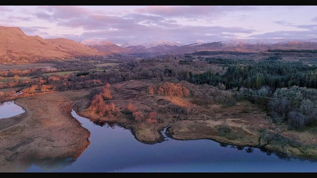 colourful pure clear water lochawe stronmilchan snow mountains trees goldenhour sunset warm winter 4k aerial light beautiful argyll djiphantom4advanced dji drone colour nature landscape scotland dalmally