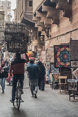 20180101 Cairo, Egypt 08920-585 (R H Kamen) Tags: cairo egypt egyptianculture middleeast northafrica adultsonly alley architecture bicycle bicyclist coveredmarket hanging incidentalpeope largegroupofpeople market marketstall rhkamen street textile