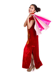 Chinese lady in chinese dress and shopping bag (I love landscape) Tags: shopping woman dress bag asian isolated chinese white happy portrait female customer young red lady girl beautiful cheerful beauty people celebration new background traditional attractive smile year long joyful festival walking holding cheongsam model carrying bags cute pretty summer hand happiness looking culture greeting asia celebrate china oriental costume congratulation