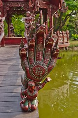 Wood carving of a 5-headed Naga in Muang Boran open air museum in Samut Phrakan province, Thailand