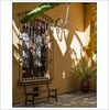 un patio al sol (pilaraf14) Tags: patio courtyard shadows sunlight sombras luzdesol banco bench plátano helecho fern ventana window