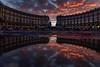 Piazza Esedra sunset (Stefano Avolio) Tags: piazzaesedra piazzadellarepubblica sunset tramonto nuvole clouds rosso piazza square roma rome stefanoavolio savolio riflesso reflection crepuscolo cielo sky twilight dusk pozzanghera puddle