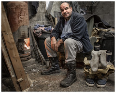 Man Shed (AEChown) Tags: fisherman shed manshed fire warmth boots socks fishinghut fishing man portrait environmentalportrait documentary socialdocumentary wood
