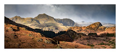 Langdales Light - in explore (Dave Fieldhouse Photography) Tags: stitchedpanorama panorama landscape langdale lakedistrict lakes cumbria cumbrianmountains langdalevalley sidepike light winter afternoon telephoto snow braken shadows forest trees lightandshade fujixpro2 fujifilm fuji wwwdavefieldhousephotographycom weather sky countryside drystonewall