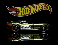 02469376253-97-Hot Wheels Fast FeLion-1 (Jim There's things half in shadow and in light) Tags: canon5dmarkiv fastfelion hotwheels tamronsp90mmf28dimacro11vcusd car classiccar closeup flame green macro red reflection toy yellow