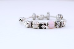 my black&diamond reflex on my pandora (moniq84) Tags: reflex pandora bracelet bijoux silver black pink violet flowers hearts bright diamond bokeh nikon 35mm white jewel jewels jewelry