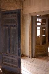 IMGP3521 Doors at Pomona (Claudio e Lucia Images around the world) Tags: pomona ghosttown ghost town diamondtown abandonedtown diamonds losttown namib namibdesert sperrgebiet namibia africa pentax pentaxk5 pentax18135