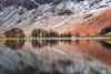 Dwarfed (Pete Rowbottom, Wigan, UK) Tags: buttermere lakedistrict borrowdale landscape dawn snow water reflection lonehouse trees pines cumbria art light red yellow tranquil beautiful shoreline unesco peterowbottom mountains lakedistrictnationalpark outdoor rocky lake waterreflections nikond750 england mirror winter cold fishinghut symmetry peaceful geotagged honister