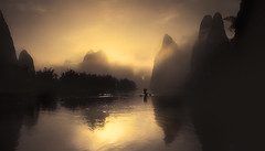 The-fisherman (Massetti Fabrizio) Tags: sunrise sun sunset rural river rosso guilin guangxi giallo guanxi gold green fog famasse fishermen mountain mount yellow yangshou yangshuo y