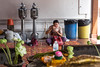 Man eating outside a Temple in Bangkok (Tiziana de Martino) Tags: man eat sittin people thai travel destination culture places visit over world thailand amazing