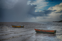Thurstaston two boats (jimmedia) Tags: thurstaston sea boats dinghy waves coast coastline coastal weather dee mersy mersey irish wales storm grey winter wirral red yellow