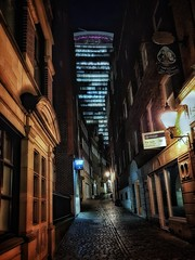 Narrow lanes and tall towers (Мaistora) Tags: street lane alley narrow old historic historical walls lights signs doors windows shadows darkness evening night sky clouds skyline skyscraper icon iconic walkietalkie tower plaza building architecture contrast counterpoint