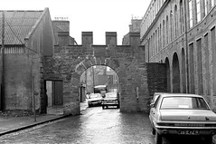Wishart Arch (Dundee City Archives) Tags: olddundeephotos wishart arch cowgate vauxhall viva jutemill juteworks archway stone gateway port 1970s cars cobbled street warehouses mts474j peugeot504 gxa288d humbersceptre