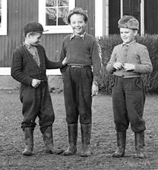 Up to something (theirhistory) Tags: boys children kids jumper trousers hat wellies belt jacket wellingtons cap