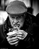 The Cornish Pasty (Neil. Moralee) Tags: neilmoralee neilmoraleesidmouth man hat cap old mature pasty eating street candid senior flat pensioner hungry food eat hot black white bw bandw blackandwhite mono whiteandblack dad grandad grandpa grandfather grip devour cornish devon sidmouth uk neil moralee nikon d7200 face portrait