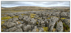 Limestone, with cement on the side (david.hayes77) Tags: yorkshire yorkshiredales thethreepeaks ribblehead 4m00 freight landscape limestone limestonepavement limestoneclints ribbleheadstation chapelledale dbcargo ews cement shed class66 66198 pano panorama