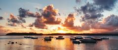 Sunset glow (Rob McC) Tags: sunset dusk goldenhour bluebay mauritius landscape seascape boat boats water skyreflections