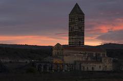 Saccargia in aurora (Paolo Dell'Angelo (JourneyToItaly)) Tags: basilicadisaccargia codrongianossassari sardegna italia basilicaoftheholytrinityofsaccargia sardiniaitaly aurora dawn