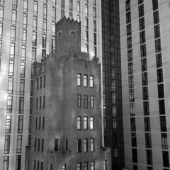 untitled (kaumpphoto) Tags: rolleiflex tlr ilford minneapolis iveyhotel street urban city building glass windows reflection arch drapes architecture view stone corner parallel angle repitition line block lamp 120