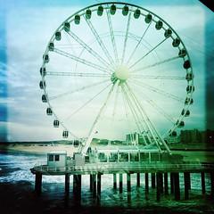 Ferris Wheel (Peter Branger) Tags: bestofweek1 bestofweek2 bestofweek3 activeassignmentweekly oldphotography ferriswheel beach scheveningen thehague netherlands