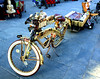 Ornamental Gold Bike with Guitar pedals in French Quarter (Lori Greig) Tags: gold golden ornamental bicycle neworleans nola frenchquarter bourbonstreet mardigras beads fleurdelis pedals sparkle decorated market
