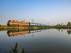 Natures Mirror (mohammedali47) Tags: railfanning express vanchinad indianrailways munroe kollam india kerala island lake water