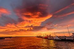 mar de fuego (Mauro Esains) Tags: mar puerto comodoro rivadavia pesca industria amanecer barcos agua cielo muelle nubes
