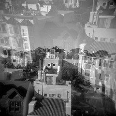 every aberration is observed with agony and suspicion, until it is declared again (Super G) Tags: 120611holga kodaktrix400 selfdeveloped film holga d76105mins65d bw blackandwhite doubleexposure houses homes buildings theavenues