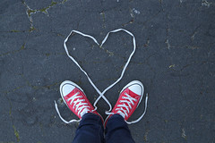 Happy Valentines! (YetAnotherLisa) Tags: love valentines valentine converse chucks red shoes asphalt laces untied cliche lookingdown atmyfeet heart hart