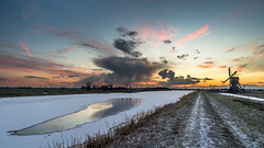 And then the sky exploded! (Rob Schop) Tags: wideangle landscape winter sonya6000 molens f10 nederland outdoor sunset zonsondergang hdr clouds bracket pink hoyaprofilters snow oudalblas cold explosion pola broekmolen samyang12mmf20 molen windmill a6000 colours wolken ice