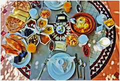 Hungry? - Marrakesh, Morocco (TravelsWithDan) Tags: breakfast food table marrakesh morocco fromabove sunlight canong16 outdoors rooftop breads jelly olives tangine honey chocolate pancakes crepes fruit figs eggs butter orangejuice coffee mosaic riadanabel cheese milk