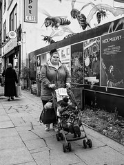 Northern Quarter 184 (Peter.Bartlett) Tags: manchester bag niksilverefex girl art unitedkingdom walking people woman facade olympuspenf wall urbanarte poster peterbartlett streetphotography lunaphoto candid urban child monochrome uk m43 microfourthirds noiretblanc bw eyecontact sign blackandwhite city fence england gb