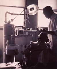 Dental office visit (National Library of Medicine - History of Medicine) Tags: africanamericans nationallibraryofhistory pictorialworks publichealthservice imagesfromthehistoryofmedicine ihm historyofmedicinedivision stillimage dentaloffice dentalchair patient africanamerican medicalpractitioner