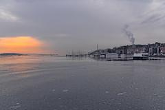 Sunset on a gray day, Oslo, Norway (Ingunn Eriksen) Tags: sunset grayday oslofjorden oslo norway akerbrygge akerbryggemarina oslofiord tjuvholmen nikond750 nikon winter ice