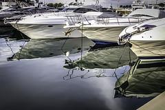 Proas reflejadas (ibzsierra) Tags: ibiza eivissa baleares canon 7d 224105 is usm reflejo reflection proa barco shuip boat vessel bateau mar sea mer mare