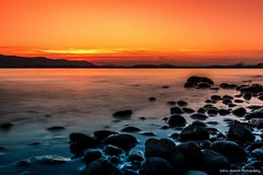 Frozen Dreams (Yarin Asanth) Tags: longexposure hegau shore beach black blue favouriteplaces island mettnau february winter2018 bolders water yarin'sorangeseason orange sun sundown sunset lakeconstance yarinasanthphotography gerdkozikfotografie