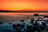 Frozen Dreams (Yarin Asanth) Tags: longexposure hegau shore beach black blue favouriteplaces island mettnau february winter2018 bolders water yarin'sorangeseason orange sun sundown sunset lakeconstance yarinasanthphotography gerdkozikfotografie