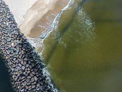 The rocks along the Mansquant Inlet, captured by a DJI Phantom 4 drone. (apardavila) Tags: atlanticocean djiphantom4 jerseyshore manasquan manasquanbeach aerial beach drone morning rocks sky snow