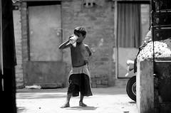 சென்னை (Kals Pics) Tags: kid boy water thirst sunnlight auto vehicle neighbourhood children posture style chennai india tamilnadu lightandlife triplicane cwc chennaiweekendclickers roi rootsofindia trouser shorts childhood vessel rottah door window autorickshaw body tiruvallikeni lightandshadow house home life people sunday kalspics streetlife