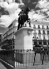 Statue of Carlos III (CountriesandCultures) Tags: spain españa madrid travel viajar puerta del sol plaza black white statue estatua carlos rey king