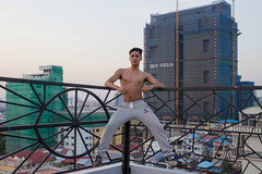 Asda (Ron van Zeeland) Tags: portret portrait man khmer cambodia phnompenh asianman asianmen model body masculine nudity muscles kroma rainbow pink sportive strong rooftop skyline buildings urban men