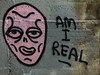 Am I Real (Steve Taylor (Photography)) Tags: amireal face head alien graffiti streetart black grey pink smile concrete texture