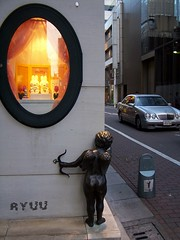 Valentine cupid in Ginza waiting to shoot someone with arrow of love... (Ola 竜) Tags: happyvalentines cupid amor sculpture littleangel bow cute kawaii love valentinesday figure street japan tokyo ginza streetcorner city urban miffy bunnies window tulips flowers lovely sweet building facade wall sidewalk pavingstones car vehicle silver mercedes japanese buildings architecture modern elipse roundwindow bunny display composition candid streetphotography statue artwork