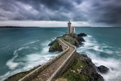Under the storm. (darklogan1) Tags: longexposure lighthouse bretagne dusk logan darklogan1 sony a7r2 canon 1635 f4 blue clouds sea sky ocean rock landscape petitminou france waves finistere brittany