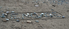 On the beach at Newcastle, County Down today (conall..) Tags: engage rock rocks shapes letters message sand