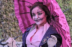 Cheshire Cat (clarkcg photography) Tags: pink cheshirecat smile eyes umbrella shirt gloves face 7dwf crazytuesdaytheme prettyinpink castleofmuskogee halloween