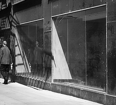Wallscape (Demmer S) Tags: street streetphotography people pedestrian walking outdoors displaywindow windows visual fireescape shadow reflection shapes wallscape scribbles dusty neglected dirty empty business vacant retail unoccupied sunlight light downtown shadows wall lines graffiti surface exterior facade display outside building storefront store windowdisplay window shopwindow urbandetails urbanscape urbanism urbanique banalities mundane commonplace unplaces urbanfragments peoplewatching shootthestreet streetlife streetshots documentary candid candidstreet citylife person urban city bw monochrome blackwhite blackandwhite blackwhitephotos blackwhitephoto graffitiphotographer