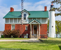 Pointe aux Barques Lighthouse (captgerryhare) Tags: lighthouse building window old brick home noperson door lawn exterior construction travel house roof architecture tree family sky outdoors fence